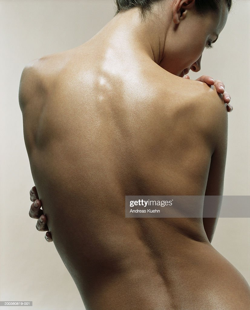 Naked young woman, rear view : Stock Photo