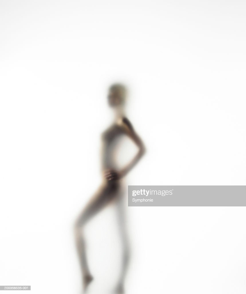 Naked young woman, side view (defocussed) : Stock Photo