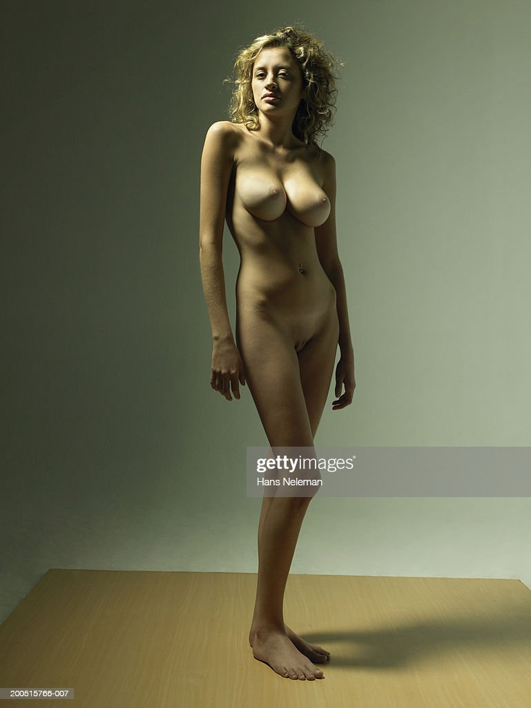 Naked young woman with blonde curly hair, portrait : Stock Photo