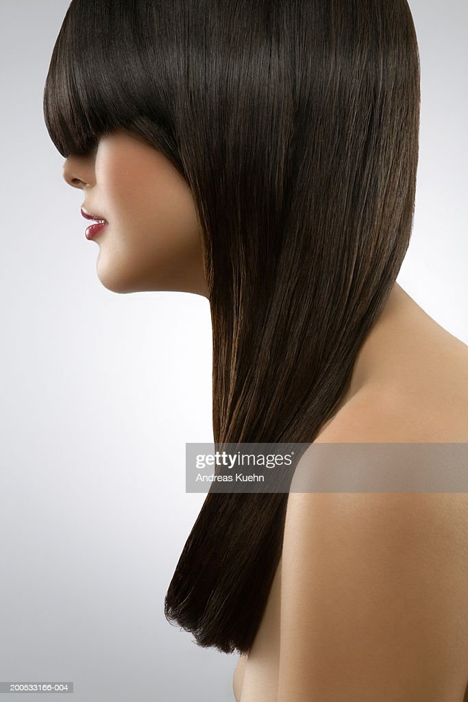 Naked young woman with hair covering eyes, close-up : Stock Photo