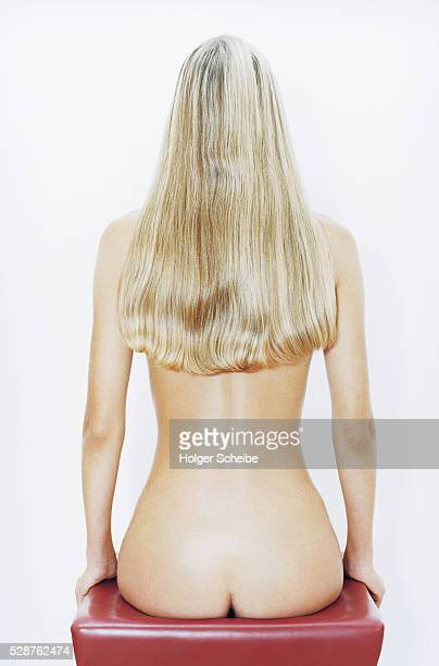 Naked young woman with long hair