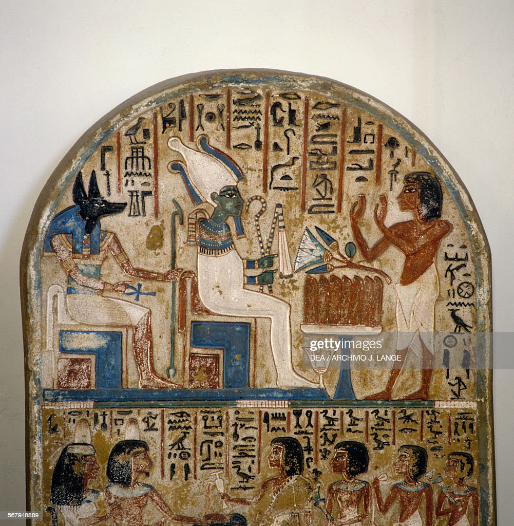 Nakhy in adoration of Osiris and Anubis detail of the Stele of Nakhy painted limestone Egyptian civilisation New Kingdom XVIIIXIX Dynasty Turin Museo...