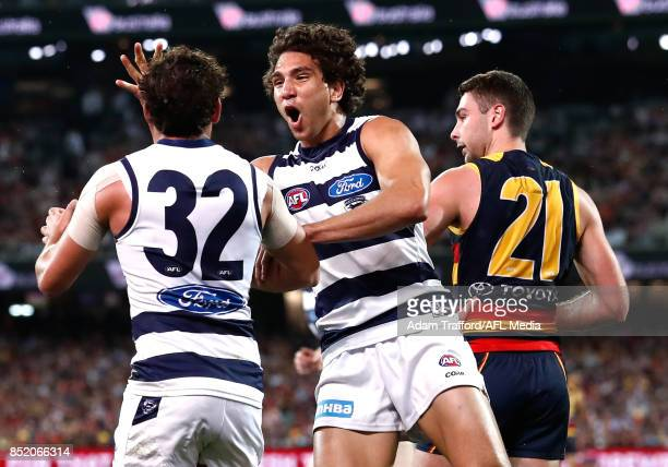 Nakia Cockatoo of the Cats celebrates with Steven Motlop of the Cats during the 2017 AFL First Preliminary Final match between the Adelaide Crows and...