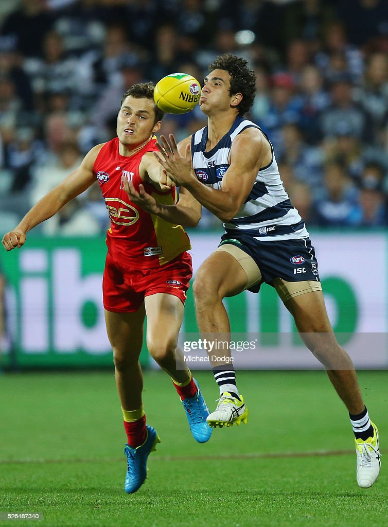 Nakia Cockatoo of the Cats (R) Kade Kolodjashnij of the Suns compete for the ball during the round six AFL match between the Geelong Cats and the Gold Coast Suns at Simonds Stadium on April 30, 2016 in Geelong, Australia.