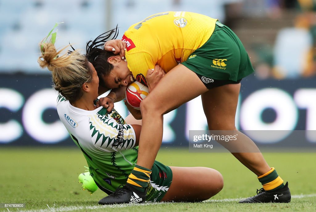 Nakia Davis-Welsh of Australia is tackled by Kiana Takairangi of Cook Islands during the 2017 Women's Rugby League World Cup match between Australia and Cook Islands at Southern Cross Group Stadium on November 16, 2017 in Sydney, Australia.