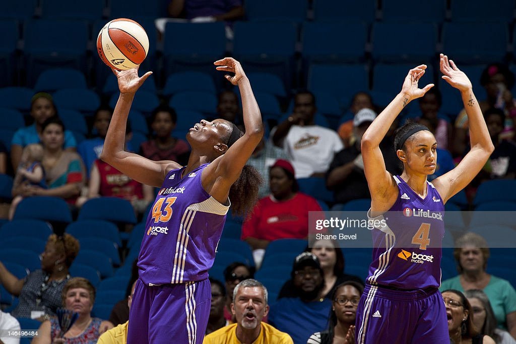 Nakia Sanford and Candice Dupree of the Phoenix Mercury react to a play during the WNBA game on June 17 2012 at the BOK Center in Tulsa Oklahoma NOTE...