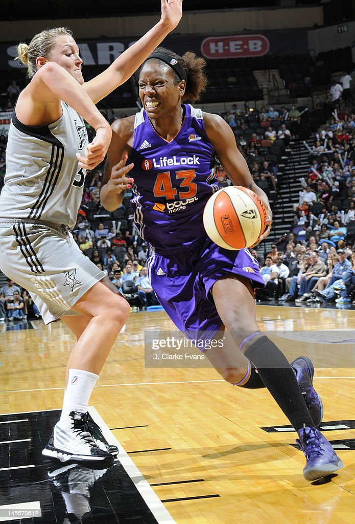 Nakia Sanford of the Phoenix Mercury drives against Jayne Appel of the San Antonio Silver Stars at the ATT Center on June 1 2012 in San Antonio Texas...