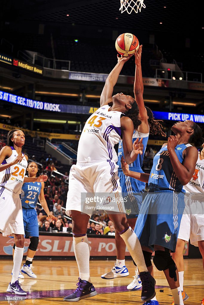 Nakia Sanford of the Phoenix Mercury goes for a rebound against the Minnesota Lynx on June 15 2012 at US Airways Center in Phoenix Arizona NOTE TO...