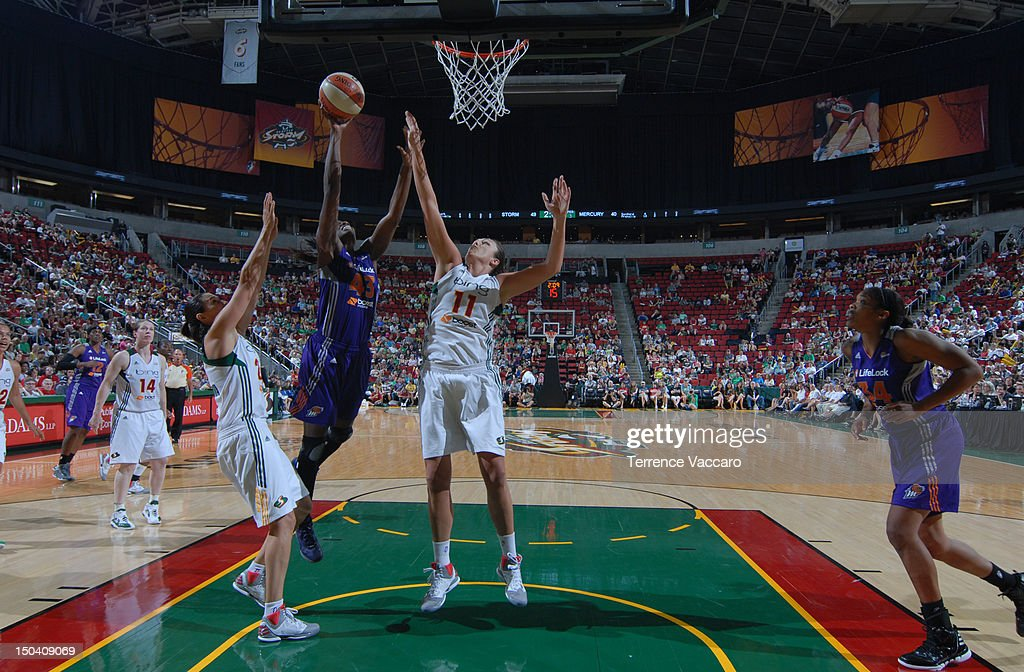 Nakia Sanford of the Phoenix Mercury goes to the basket against Ewelina Kobryn of the Seattle Storm during the game on August 16 2012 at Key Arena in...