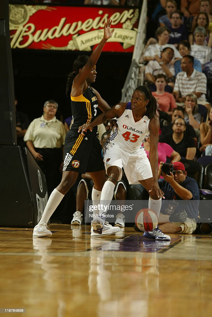 Nakia Sanford of the Phoenix Mercury is guarded by Tiffany Jackson of the Tulsa Shock in a WNBA game played on July 10 at US Airways Center in...