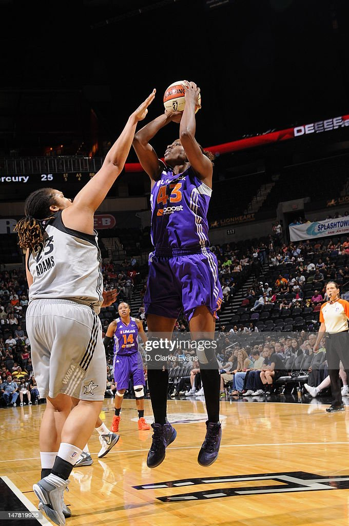 Nakia Sanford of the Phoenix Mercury shoots against Danielle Adams of the San Antonio Silver Stars at the ATT Center on July 3 2012 in San Antonio...