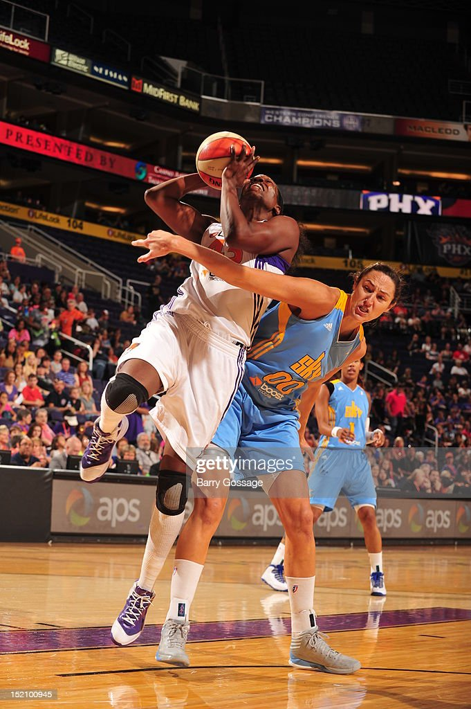 Nakia Sanford of the Phoenix Mercury shoots against Ruth Riley of the Chicago Sky on September 16 2012 at US Airways Center in Phoenix Arizona NOTE...