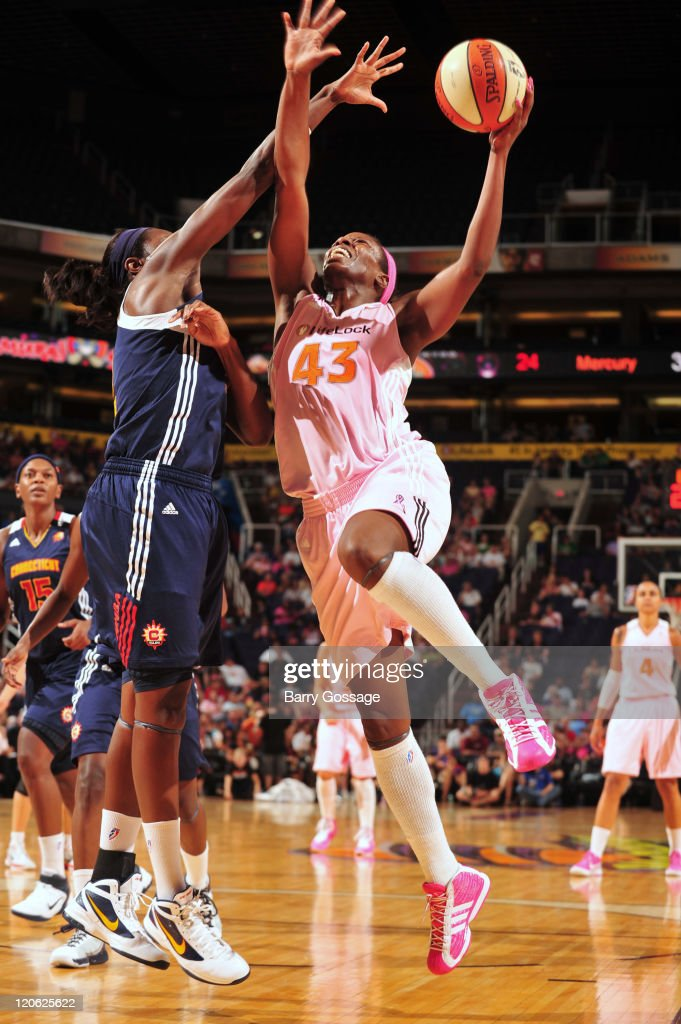 Nakia Sanford of the Phoenix Mercury shoots against Tina Charles of the Connecticut Sun on August 7 2011 at US Airways Center in Phoenix Arizona NOTE...