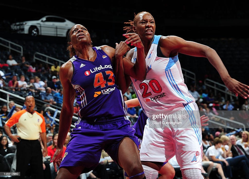 Nakia Sanford of the Phoenix Mercury tries for position against Sancho Lyttle of the Atlanta Dream at Philips Arena on May 31 2012 in Atlanta Georgia...