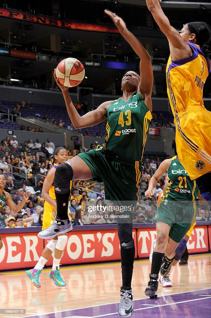 Nakia Sanford of the Seattle Storm attempts a layup against Candace Parker of the Los Angeles Sparks during a game at Staples Center on May 26 2013...