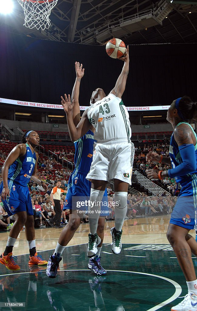 Nakia Sanford of the Seattle Storm grabs a rebound against the New York Liberty during the game on June 28 2013 at Key Arena in Seattle Washington...