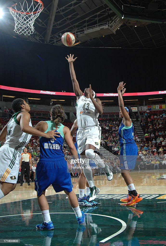 Nakia Sanford of the Seattle Storm shoots against the New York Liberty during the game on June 28 2013 at Key Arena in Seattle Washington NOTE TO...