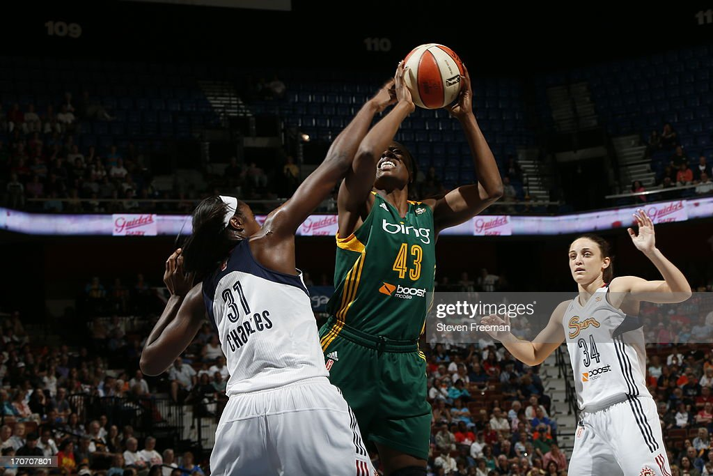 Nakia Sanford of the Seattle Storm shoots against Tina Charles of the Connecticut Sun on June 16 2013 at Mohegan Sun Arena in Uncasville Connecticut...