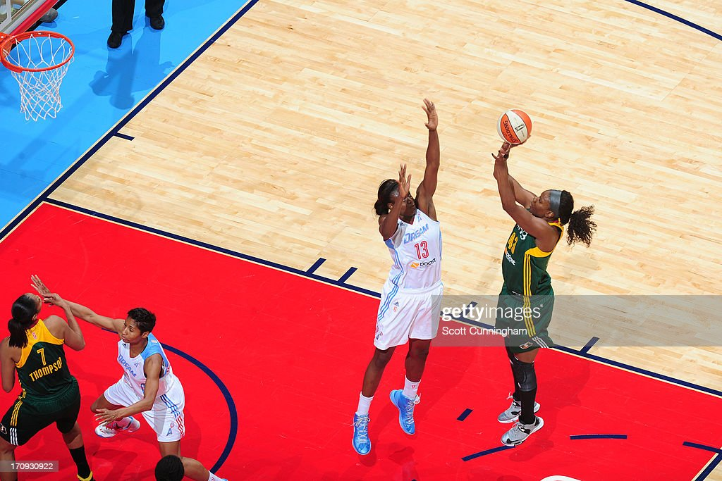 Nakia Sanford of the Seattle Storm shoots over Aneika Henry of the Atlanta Dream at Philips Arena on June 14 2013 in Atlanta Georgia NOTE TO USER...