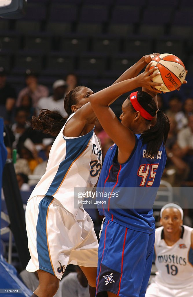 Nakia Sanford #43 of the Washington Mystics applies pressure to Kara Braxton #45 of the Detroit Shock during a game at MCI Center on August 11, 2006 in Washington, D.C. The Mystics won 78-66.