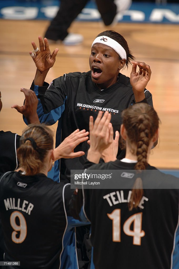 Nakia Sanford #43 of the Washington Mystics greets her teammates prior to a game against the Indiana Fever at MCI Center on June 27, 2006 in Washington, D.C. The Fever won 74-67.