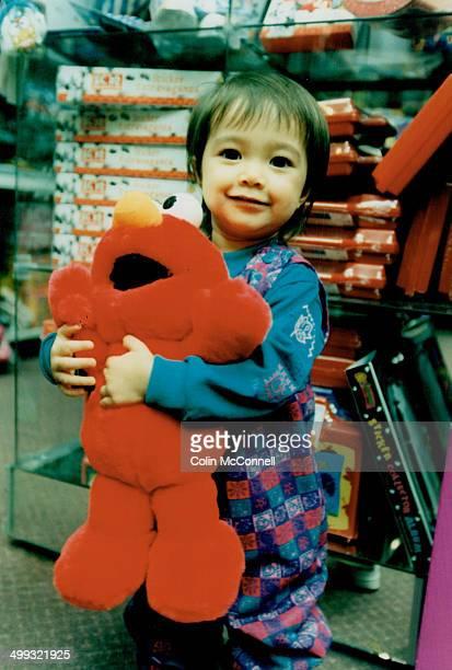 Nakita Byrne with Tickle Me Elmo doll