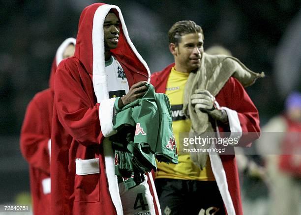 Naldo and Tim Wiese of Werder wear a Santa Claus coat as they celebrates after winning the Bundesliga match between Werder Bremen and VFL Wolfsburg...