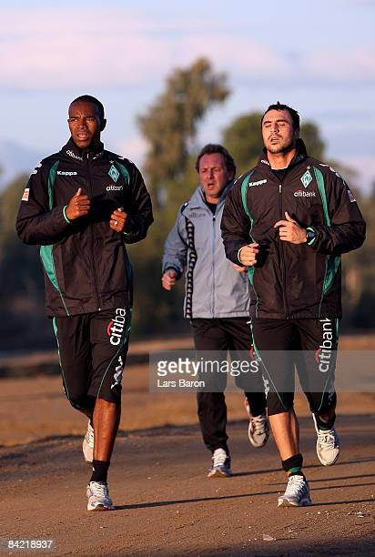 Naldo Hugo Almeida and assistant coach Matthias Hoenerbach run during day two of Werder Bremen training camp on January 9 2009 in Belek Turkey