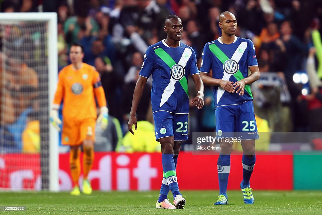 Naldo, Josuha Guilavogui and goalkeeper Diego Benaglio of Wolfsburg react after Cristiano Ronaldo scored his team's third goal during the UEFA Champions league Quarter Final Second Leg match between Real Madrid and VfL Wolfsburg at Estadio Santiago Bernabeu on April 12, 2016 in Madrid, Spain.