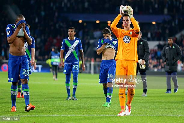 Naldo Luiz Gustavo Ricardo Rodriguez and Diego Benaglio of Wolfsburg look dejected after losing the UEFA Champions League Group B match between PSV...