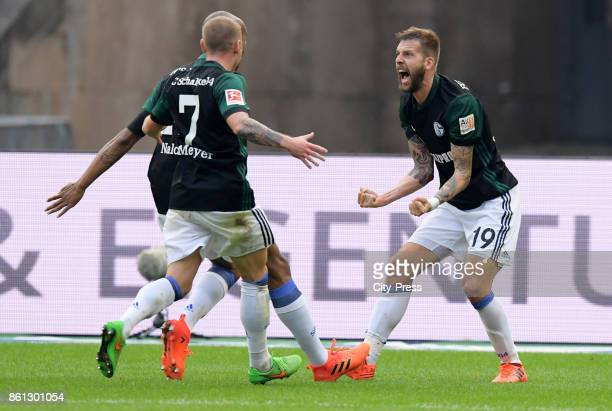 Naldo Max Meyer and Guido Burgstaller of FC Schalke 04 celebrate after scoring the 02 during the game between Hertha BSC and Schalke 04 on october 14...