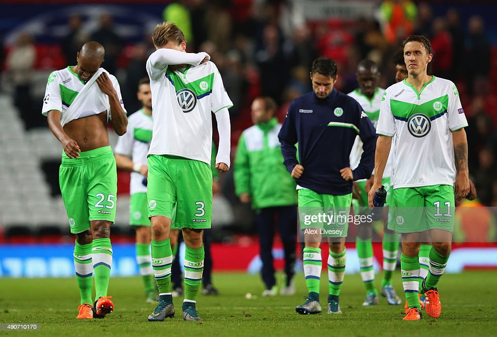 Naldo, Nicklas Bendtner, Christian Trasch and Max Kruse of VfL Wolfsburg look dejectd after defeat in the UEFA Champions League Group B match between Manchester United FC and VfL Wolfsburg at Old Trafford on September 30, 2015 in Manchester, United Kingdom.