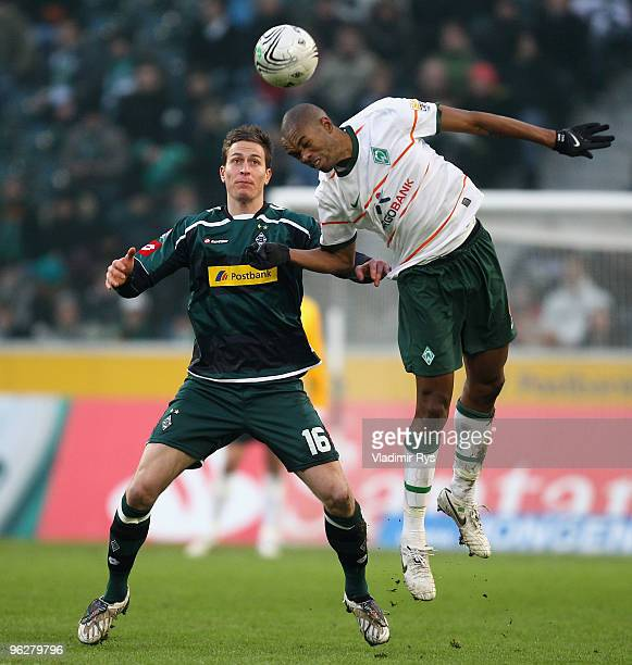 Naldo of Bremen and Rob Friend of Moenchengladbach in action during the Bundesliga match between Borussia Moenchengladbach and SV Werder Bremen at...