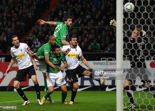 Naldo of Bremen heads his team's equalizing goal during the Bundesliga match between SV Werder Bremen and Borussia Moenchengladbach at Weser Stadium...
