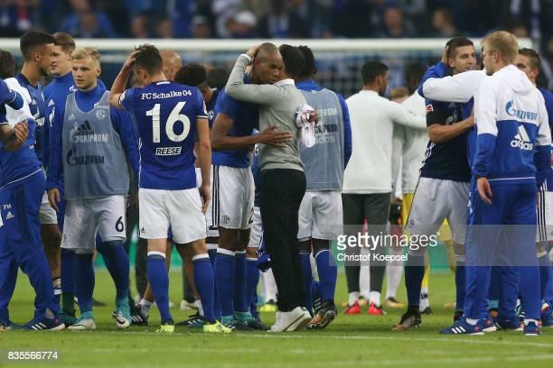 Naldo of Schalke and Coach Domenico Tedesco of Schalke embrace after the Bundesliga match between FC Schalke 04 and RB Leipzig at VeltinsArena on...