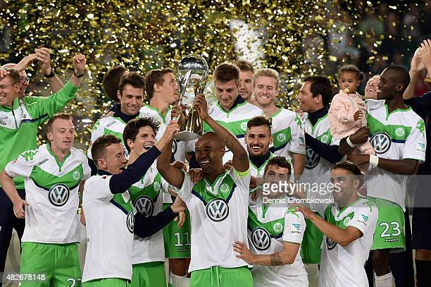 Naldo of VfL Wolfsburg lifts the trophy after the DFL Supercup 2015 match between VfL Wolfsburg and FC Bayern Muenchen at Volkswagen Arena on August...