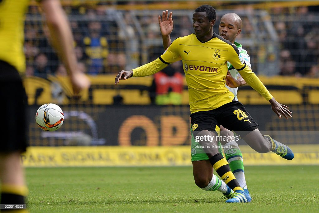 Naldo of Wolfsburg (R) and Adrian Ramos (L) of Dortmund battle for the ball during the Bundesliga match between Borussia Dortmund and VfL Wolfsburg at Signal Iduna Park on April 29, 2016 in Dortmund, Germany.