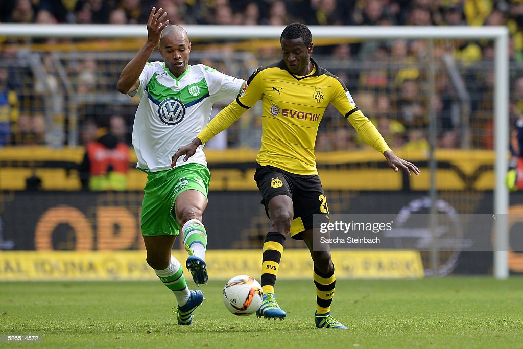 Naldo of Wolfsburg and Adrian Ramos of Dortmund battle for the ball during the Bundesliga match between Borussia Dortmund and VfL Wolfsburg at Signal Iduna Park on April 29, 2016 in Dortmund, Germany.