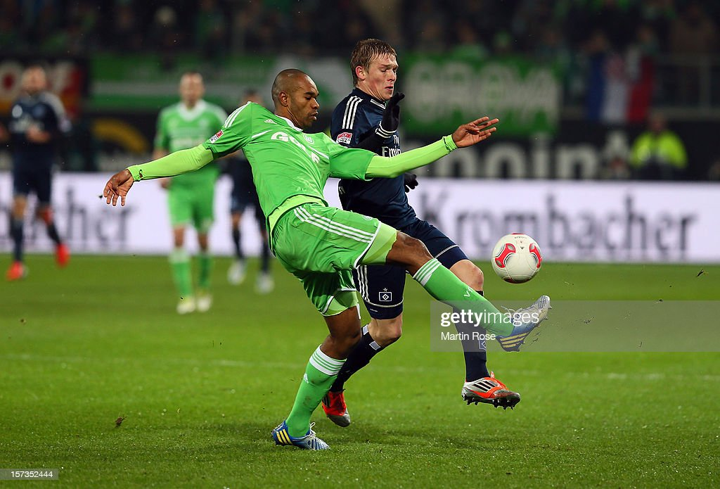 Naldo (L) of Wolfsburg and Artjoms Rudnevs (R) of Hamburg battle for the ball during the Bundesliga match between VfL Wolfsburg and Hamburger SV at Volkswagen Arena on December 2, 2012 in Wolfsburg, Germany.