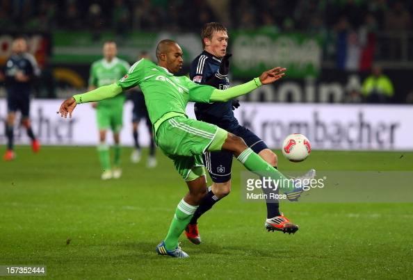 Naldo of Wolfsburg and Artjoms Rudnevs of Hamburg battle for the ball during the Bundesliga match between VfL Wolfsburg and Hamburger SV at...