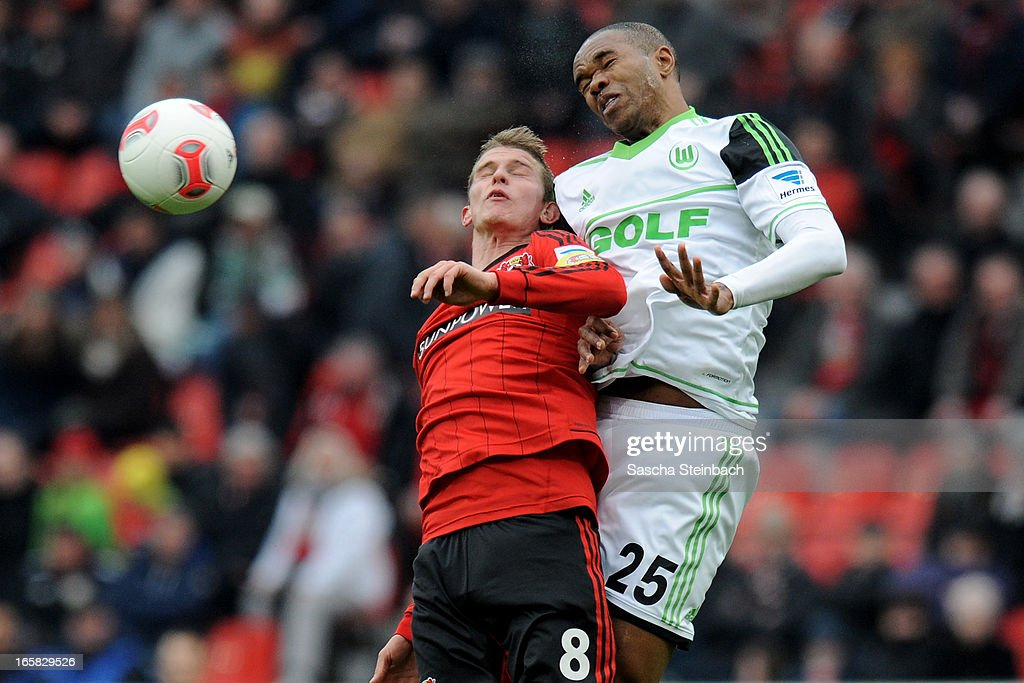 Naldo (R) of Wolfsburg and Lars Bender (L) of Leverkusen (L) battle for and header during the Bundesliga match between Bayer 04 Leverkusen and VfL Wolfsburg at BayArena on April 6, 2013 in Leverkusen, Germany.