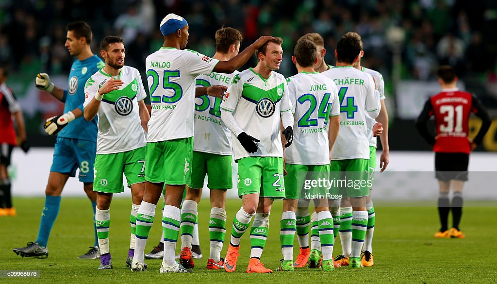 Naldo #25 of Wolfsburg celebrate with tea mate Max Arnold #27 after the Bundesliga match between VfL Wolfsburg and FC Ingolstadt at Volkswagen Arena on February 13, 2016 in Wolfsburg, Germany.