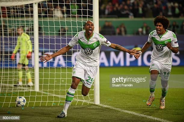 Naldo of Wolfsburg celebrates after scoring a goal to level the scores at 11 during the UEFA Champions League group B match between VfL Wolfsburg and...