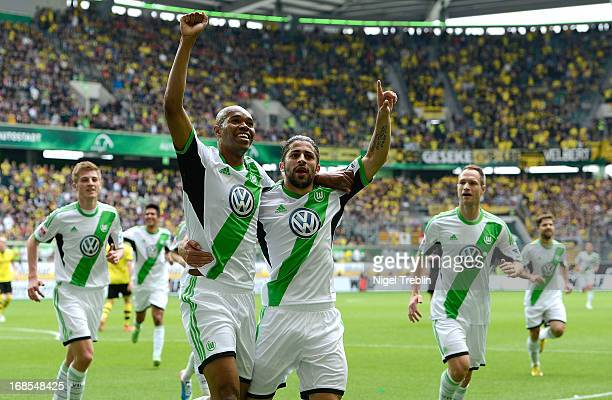 Naldo of Wolfsburg celebrates scoring his goal with Ricardo Rodriguez of Wolfsburg during during the Bundesliga match between Vfl Wolfsburg and...