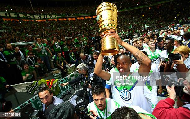 Naldo of Wolfsburg celebrates with the trophy after winning the DFB Cup Final match between Borussia Dortmund and VfL Wolfsburg at Olympiastadion on...
