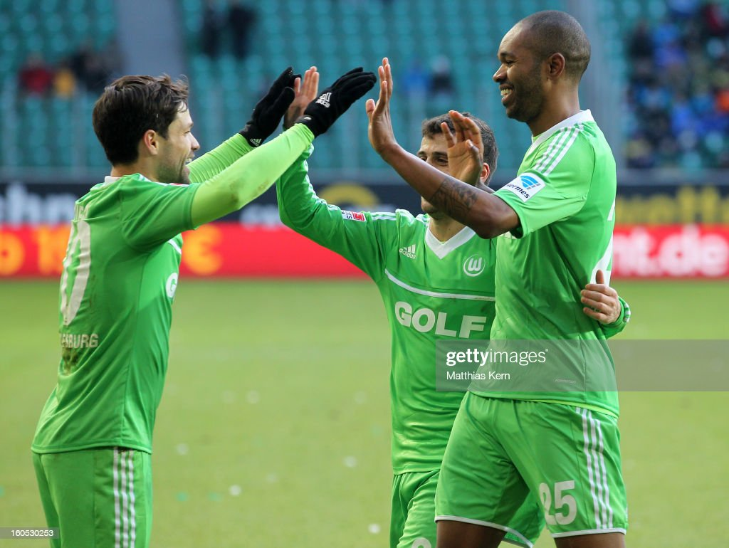 Naldo (R) of Wolfsburg jubilates with team mate Diego (L) after scoring the first goal during the Bundesliga match between VFL Wolfsburg and FC Augsburg at Volkswagen Arena on February 2, 2013 in Wolfsburg, Germany.