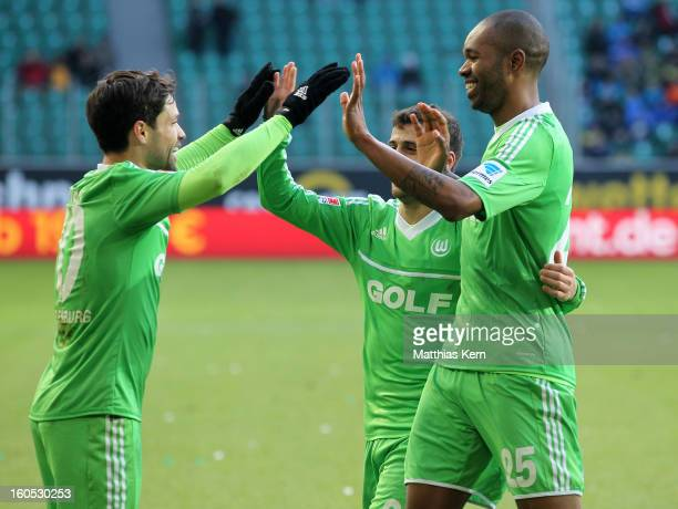 Naldo of Wolfsburg jubilates with team mate Diego after scoring the first goal during the Bundesliga match between VFL Wolfsburg and FC Augsburg at...