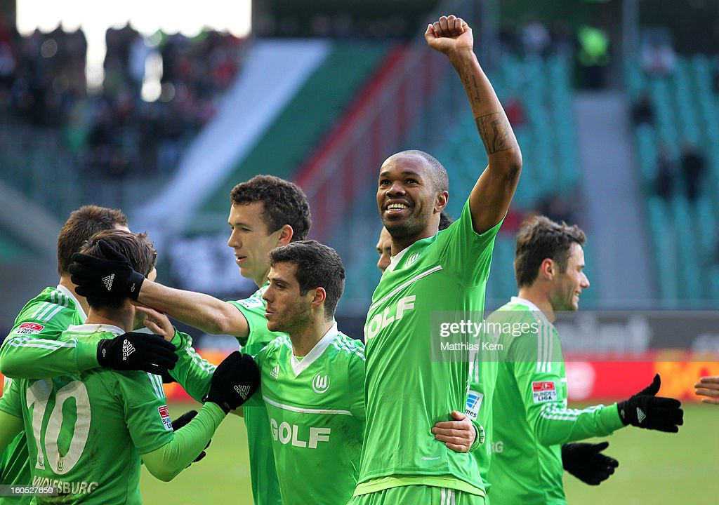 Naldo (R) of Wolfsburg jubilates with team mates after scoring the first goal during the Bundesliga match between VFL Wolfsburg and FC Augsburg at Volkswagen Arena on February 2, 2013 in Wolfsburg, Germany.