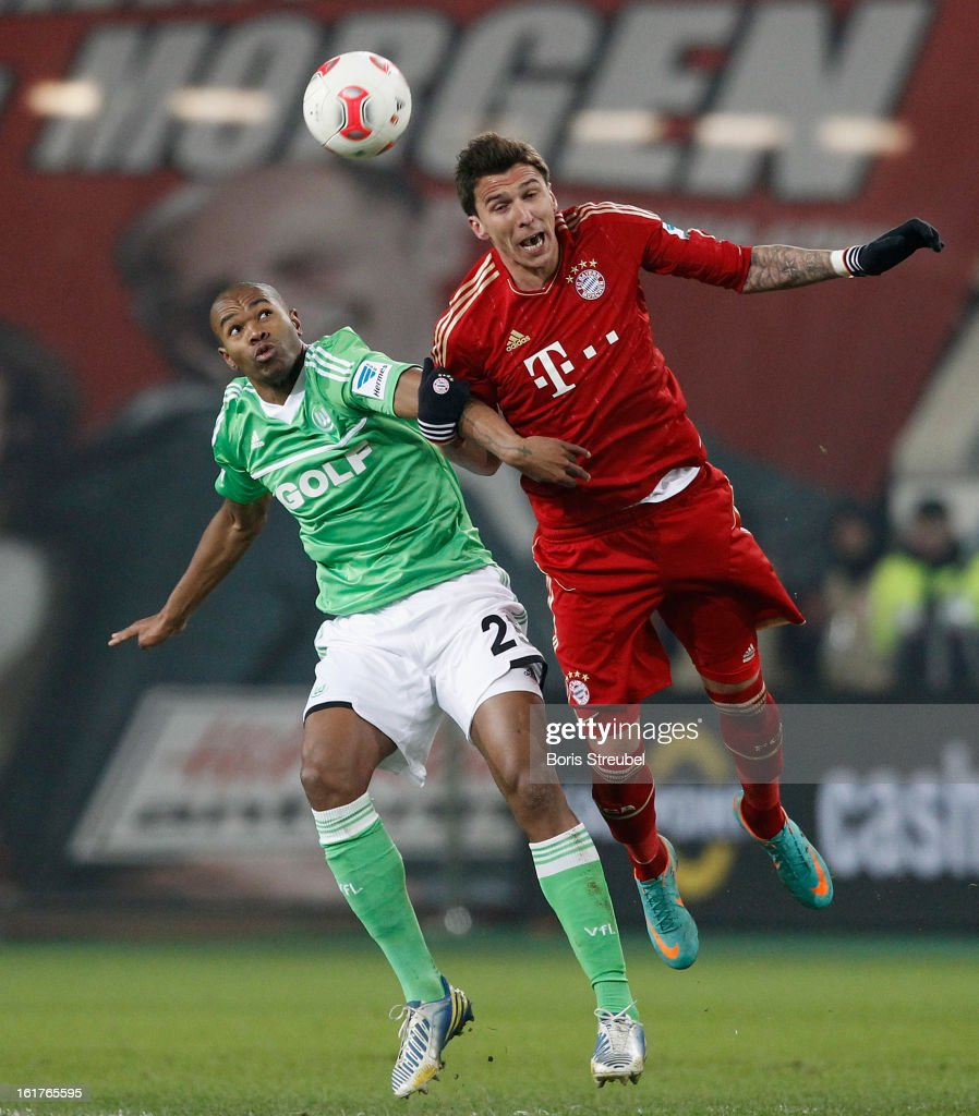 Naldo (L) of Wolfsburg jumps for a header with <a gi-track='captionPersonalityLinkClicked' href=/galleries/search?phrase=Mario+Mandzukic&family=editorial&specificpeople=4476149 ng-click='$event.stopPropagation()'>Mario Mandzukic</a> (R) of Muenchen during the Bundesliga match between VFL Wolfsburg and FC Bayern Muenchen at Volkswagen Arena on February 15, 2013 in Wolfsburg, Germany.
