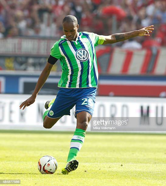 Naldo of Wolfsburg kicks the ball during the Bundesliga match between 1 FC Koeln and VfL Wolfsburg at RheinEnergieStadion on August 22 2015 in...